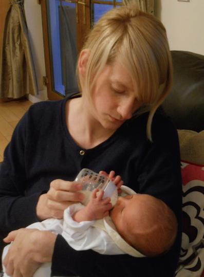 Lindsay feeding newborn son, Reuben